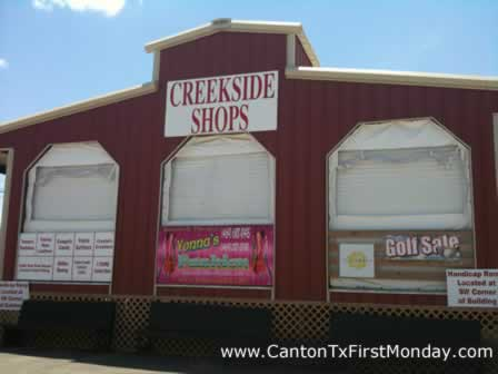 Creekside Shops at Canton First Monday flea market provide indoor shopping booths and storefronts